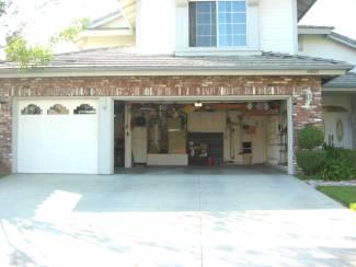 open garage doorKSPR News Cops warn homeowners to keep garage doors closed to
